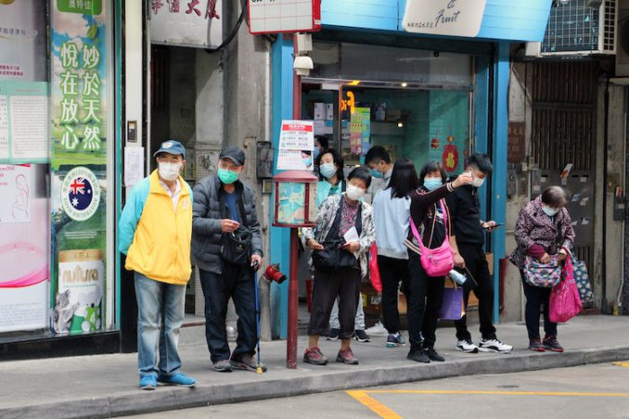 Chinese people waiting the bus